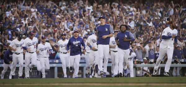 Dodgers Celebrate After Winning Wild Card Game